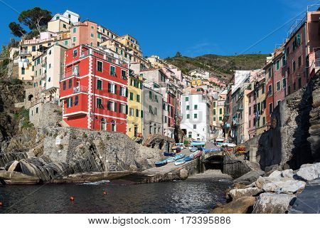 View on architecture of Riomaggiore town. Riomaggiore is one of the most popular town in Cinque Terre National park, Italy