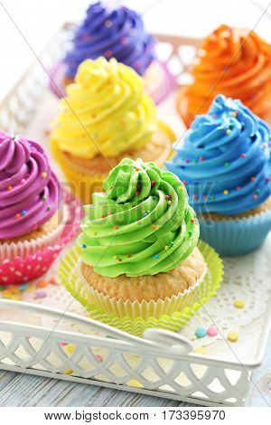 Tasty Cupcakes In Tray On A White Wooden Table
