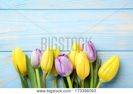 Bouquet Of Tulips On Blue Wooden Table