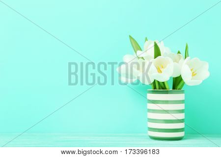 Bouquet Of Tulips In Vase On Green Background