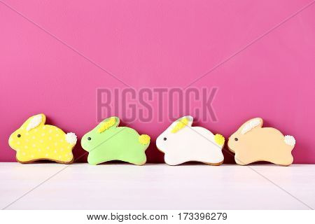 Colorful Easter Cookies On The Pink Background