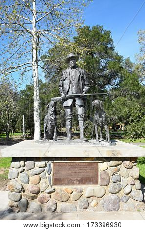 ORANGE, CALIFORNIA - FEBRUARY 24, 2017: James Irvine Statue. The monument titled, The Winds of Change, is in Irvine Regional Park, the oldest regional park in California.