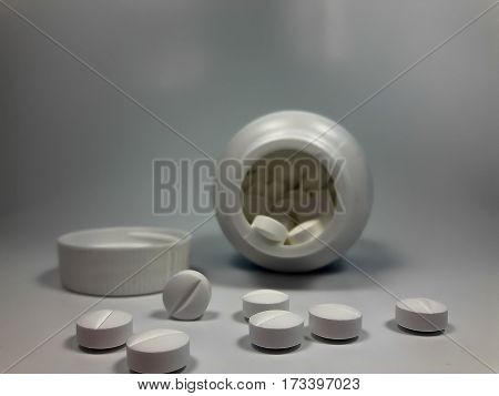 some pills on a black background closeup.