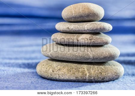 Stone Pyramid Over Blue Blurred Background