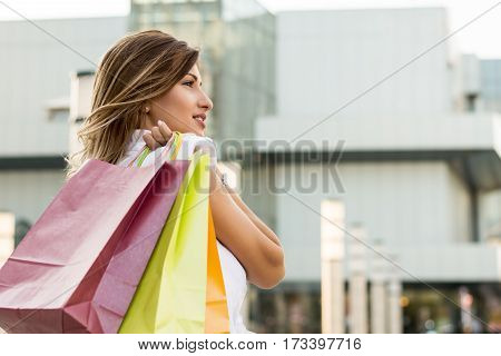 Young woman shopping in the downtown. Concept.