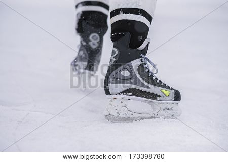 hockey players legs close-up during a game on ice