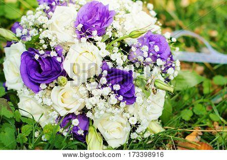 wedding bouquet on green grass in weding day