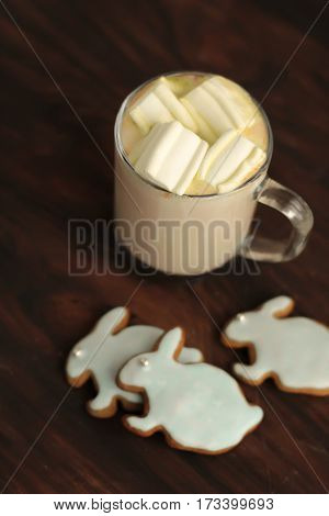 Mug Full Of Cocoa And Hare Shaped Cookies