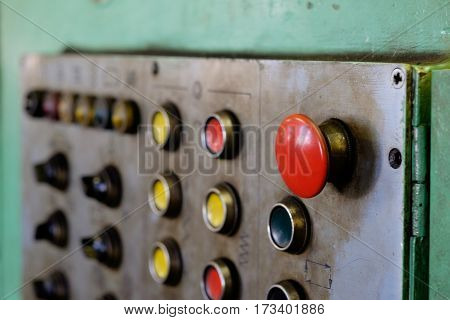 Panel with buttons and red big button on factory