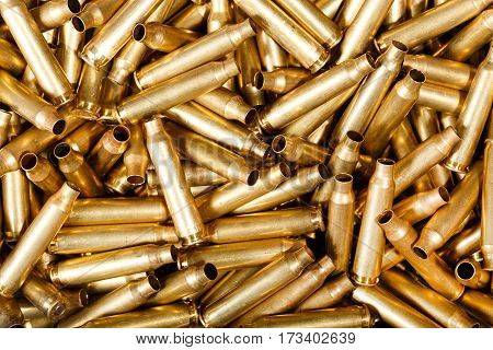 Used 56 mm bullets close-up photo. Texture of ammo.