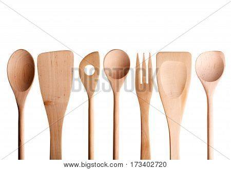 Wooden spoon spatula fork on a white background.