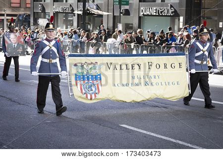 NEW YORK - 11 NOV 2016: Valley Forge Military Academy and College, students in uniform carry the banner and march in Americas Parade up 5th Avenue on Veterans Day in Manhattan.