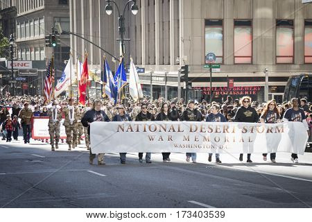 NEW YORK - 11 NOV 2016: Vets march behind the banner for National Desert Storm War Memorial in Americas Parade up 5th Avenue on Veterans Day in Manhattan.