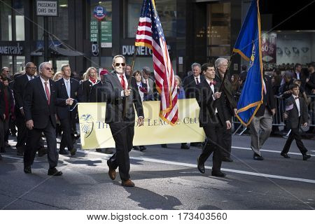 NEW YORK - 11 NOV 2016: Union League Club, parade participants carry the banner and march in Americas Parade up 5th Avenue on Veterans Day in Manhattan.