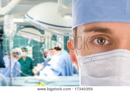 Male surgeon with his team in operation room