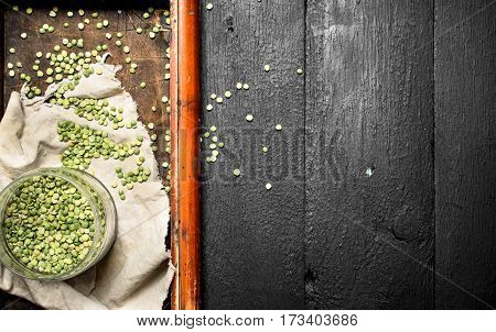 Green Beans In Bowl On Old Tray . On The Black Wooden Table.