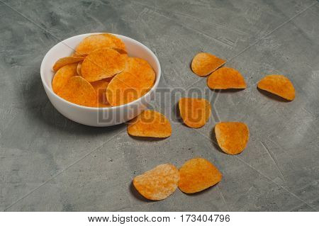 potato chips on a gray old concrete table