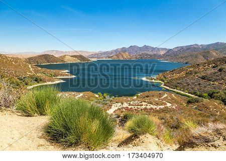 A view of The Pacific Crest Trail as it winds around Silverwood Lake in San Bernardino County California