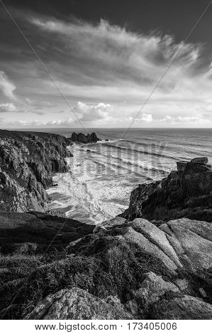 Rocks in the foreground at St Just Penzance Cornwall in black and white