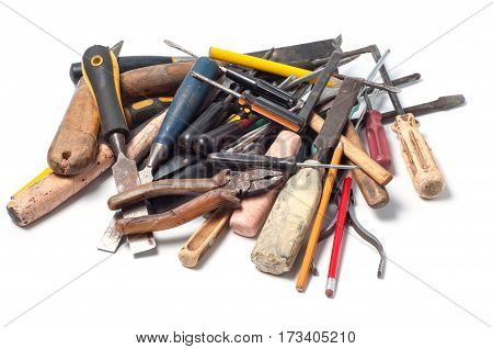 Old vintage tools, pliers, screwdrivers, knife, hammers, pencils, chisel, awl and nippers isolated on white background