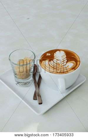 Hot Latte And Sugar On The White Table