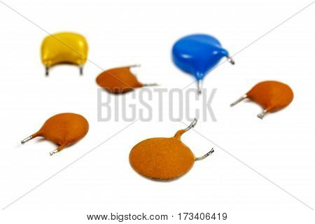 Set of capacitors in colored cases on a white background