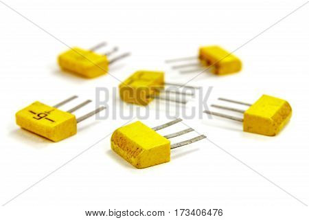 Set of bipolar transistors on a white background closeup