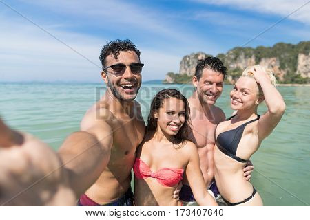 Young People Group On Beach Summer Vacation, Happy Smiling Friends Taking Selfie Photo In Water Sea Ocean Holiday Travel