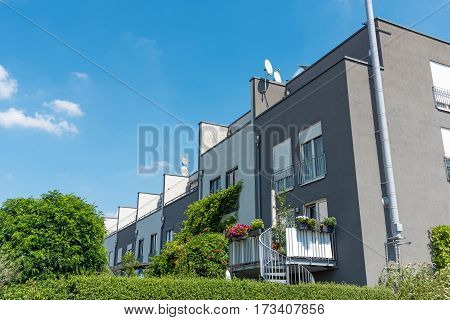 Serial houses with gardens seen in Berlin, Germany