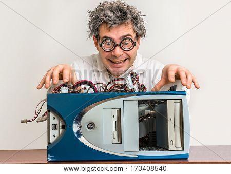 Crazy Engineer Or Scientist Repairing Computer