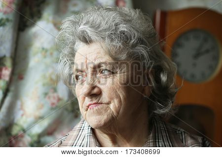 Looking grandmother portrait on a dark background