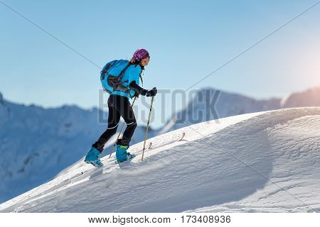 Uphill Girl With Seal Skins And Ski Mountaineering