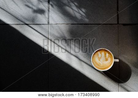 Coffee Cup With Latte Art On The Floor