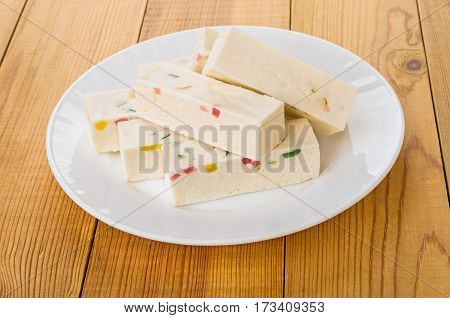 Heap Of Candy With Marmalade In White Plate