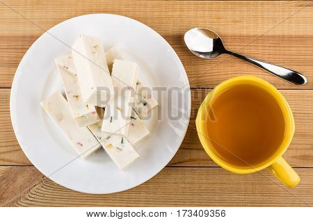 Heap Of Candy With Marmalade In Plate And Tea