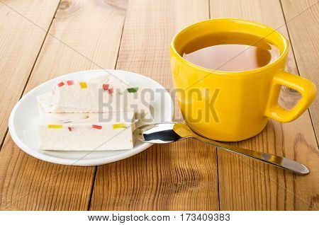 Candy With Marmalade In White Plate And Cup Of Tea