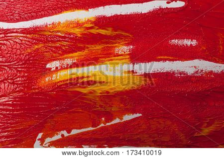 Artists oil paints, red background. Abstract colored splashes and stains
