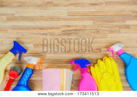Spring cleaning concept - colorful spays and rubbers border