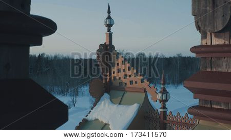 Roof of traditional snow-covered russian cottage - terem in a forest.. Top view 4K