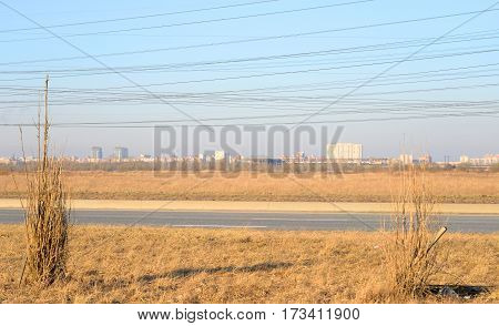 Early spring landscape on the outskirts of St. Petersburg at sunny day Russia.