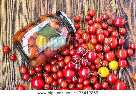 Canning fresh tomatoes with onions in jelly marinade. Vegetable salads for winter. Glass jar of homemade tasty canned tomatoes close up. Preserved food