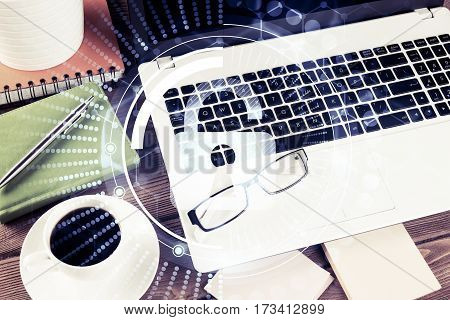 Opened laptop and other office stuff on wooden table