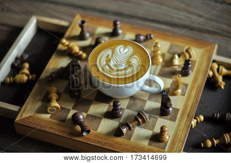 Coffee Cup With Latte Art On The Chessboard