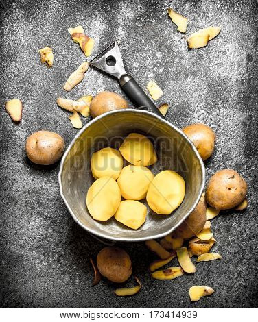 Fresh Shelled Organic Potatoes In The Old Bucket. On Rustic Background.