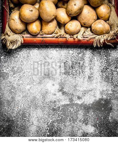 Fresh Potatoes In An Old Tray. On Rustic Background