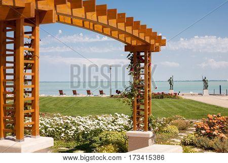 The beach of Lake Balaton with rose trellis and flower garden at Balatonfured hungary
