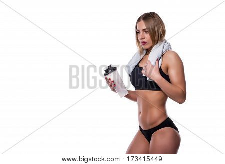 Attractive Sexy Woman After Workout With Towel And Shaker Isolated Over White Background. Healthy Gi