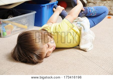 yoga bow pose Little girl playing and lying on carpet happy child making home yoga home workout