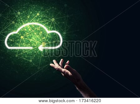 Man hand holding cloud computing concept in palm