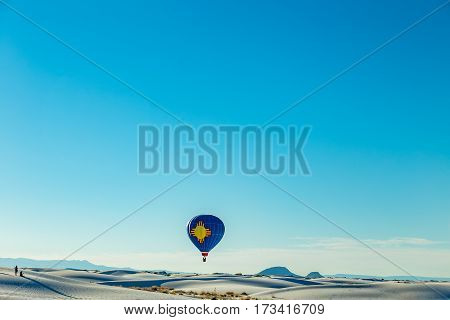 Colorful hot air balloons fly over the glistening gypsum dunes at White Sands National Monument during the 2016 Balloon Invitational.